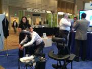 Chair massage in an exhibit booth