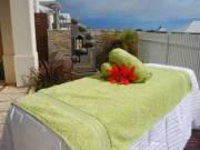 Male massage therapist looking to massage and relax you at your home